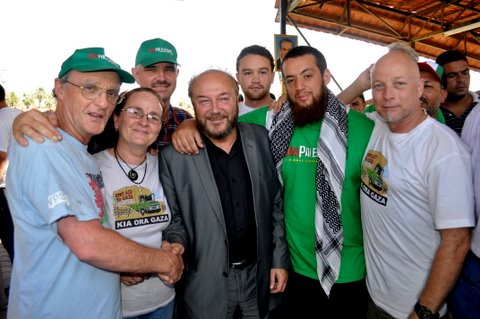 Viva Palestina founder George Galloway (centre) congratulates the Kia Ora Gaza team for their significant contribution to the success of the international aid convoy to Gaza. From left: Roger Fowler, Julie Webb-Pullman, Pat O'Dea, Hone Fowler, Mousa Taher and Chris van Ryn