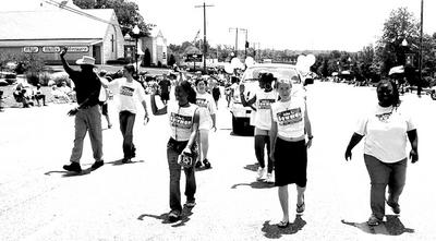 John Bowman marching with YCL, 2004