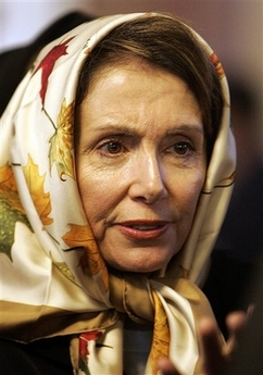 Pelosi in Damascus, Syria sporting a hijab, the head covering traditionally worn by Muslim women. (AP Photo/Hussein Malla)