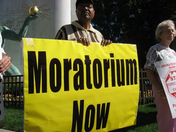 Supporters of the Moratorium Now! Coalition protest outside Detroit city headquarters on Friday, October 10, 2008