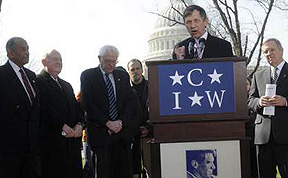 Rep. John Conyers, Sen. Bernie Sanders, Rep. Dennis Kucinich (speaking) and Sen. Dick Durbin, joined by AFL-CIO President John Sweeney (second from left) gathered in the shadow of the Capitol building in Washington, DC, March 13th 2008